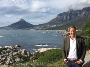 Jay Lauf In Cape Town with The Lion's Head mountaintop to his right and Table mountain to his left.